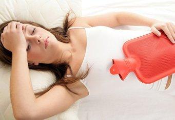 Тянущая боль в области яичников у женщины, о чем это говорит?